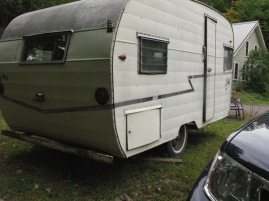 My Shasta camper, vintage 1961, purchased blind on ebay for a bit too much, gutted on the inside, currently a work in progress. So cool. If only I could wear the shoes inside it.