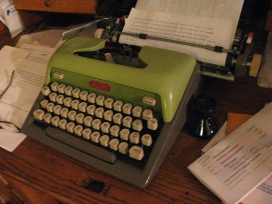 My favorite typewriter so far. An old avocado green Royal with the great Art Deco label on front. Works like a charm and has adjustable action. I usually tire of them and sell them eventually, but I suspect this one will live in the camper with me and Pluto.